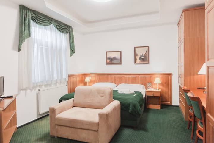 Accomodation near the city center for 2-3 persons