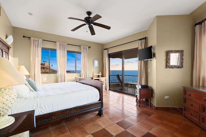Main King-Bed Master Suite has veranda with sitting area overlooking pool and 180 degree view of the ocean! No bedrooms share walls, which creates a lovely sense of privacy! (Every room has an ensuite full bath, as well!)