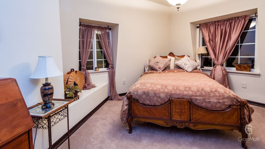 This Spacious suite has a double size bed, with a large walk-in closet and  private bathroom