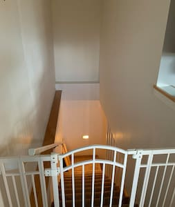 Well lit stairs leading to private downstairs studio suite.