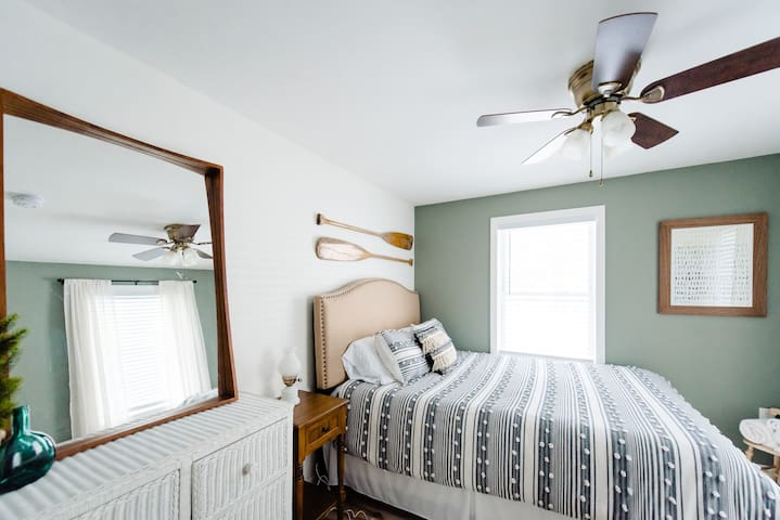 Our smallest guest bedroom is conveniently located on the main floor, adjacent to the kitchen and across from the bathroom.