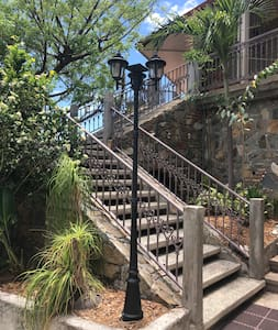 The lighting at the bottom of the steps is solar and automatically comes on at night. There are motion detecting lights on the garage as well as the top of the steps that light the wide, not steep steps from the parking area to the villa entrance.