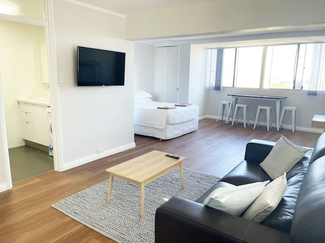 Studio Apartment 101 is brand new throughout including all new flooring, wall mounted smart tv, couch and furnishings.