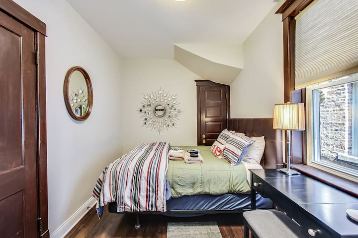 Primary bedroom with queen size bed, all bedding, extra blankets in closet and dressing table with mirror. Large closet with  wood hangers, luggage rack, iron and mini ironing board.