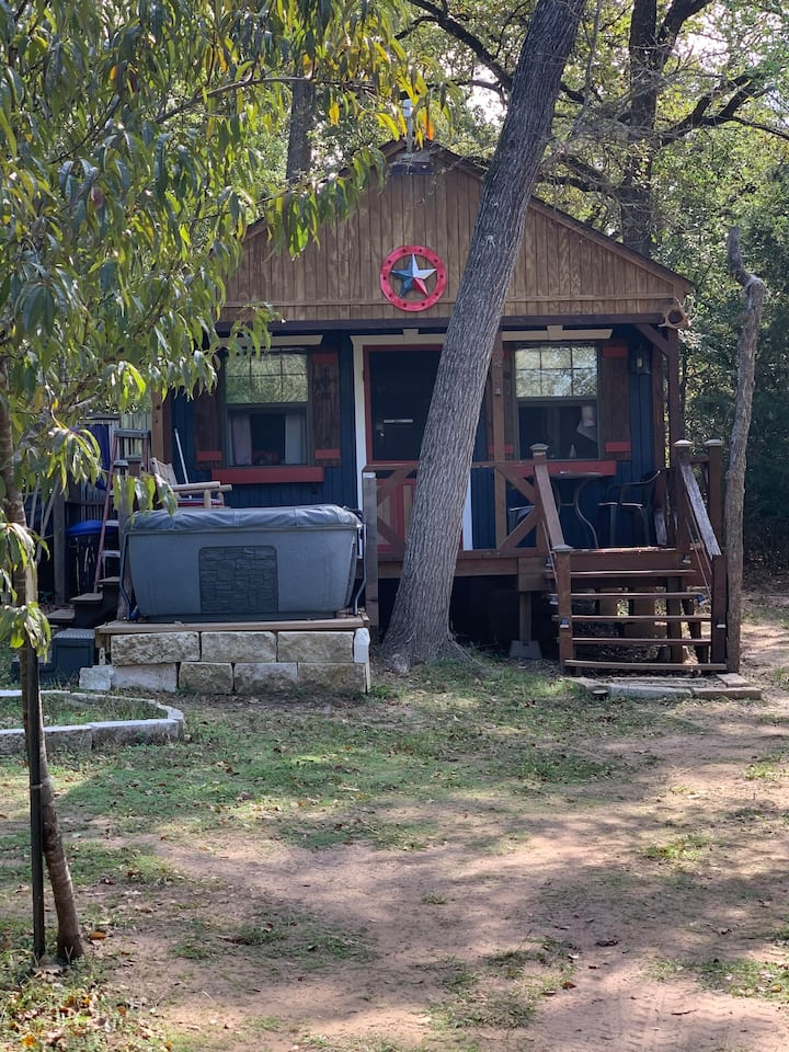 Private cabin w/hot tub, in woods, small lake view