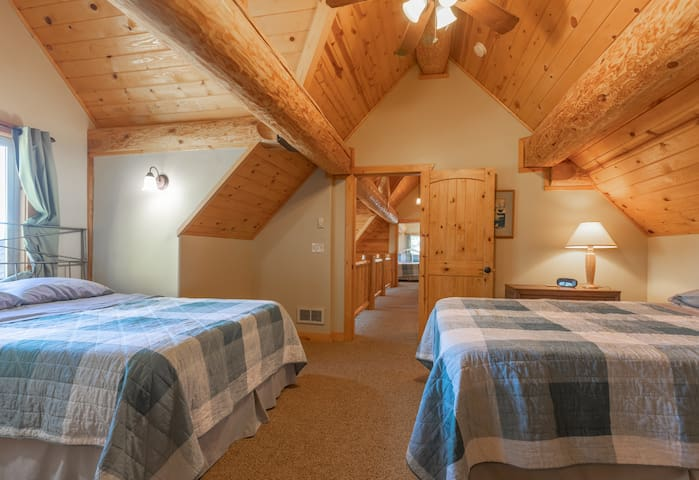 Bedroom 3 is upstairs and has 2 queen beds.