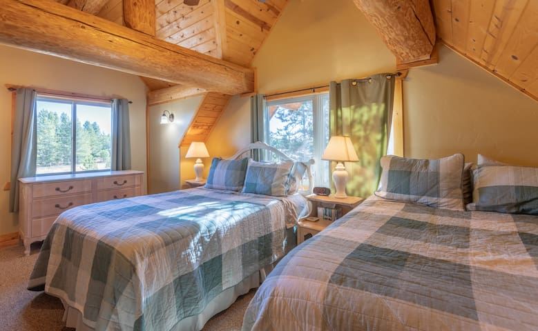 Upstairs bedroom has 2 queen beds and plenty of natural lighting and views.