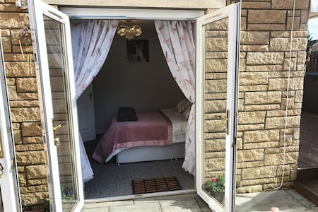 Double patio doors to enter with room to move around the bed, all doorways in The Wee Studio are 100cm wide and level