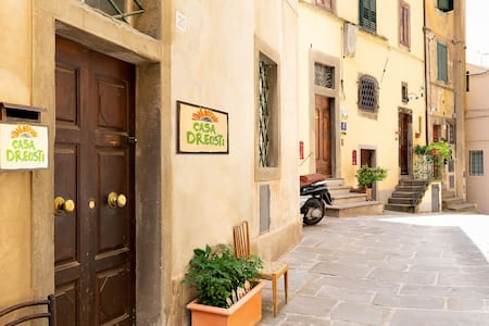 Entrance to Casa Dreosti. Lights at door entrance. Pathway is well lit up at night by the Cortona Municipality