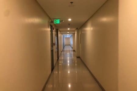 Well lit hallways going to the unit