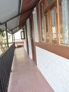 Verandah at the entrance of the rooms.