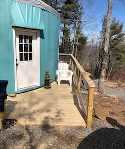 Flat gravel drive at the same elevation as the deck at the entry.  All openings are 36 inches wide and a sofa bed is on the main level.