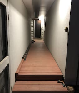 There are 2 steps and the walkway is 1.1m wide. The door is standard 820mm wide