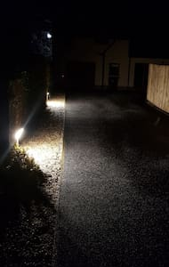 private path to property has 2  lights  and 2   motion sensor lights on outside of the property