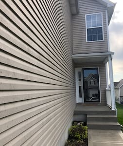 Just right of the driveway and garage door is a walk path to 3 steps to enter through the front door entrance.