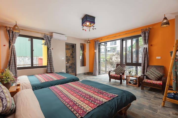 Twin bed with balcony and City View