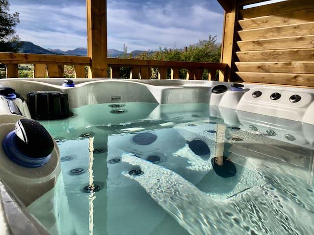 Lodge 10 - Spa privatif vue sur le Massif du Sancy