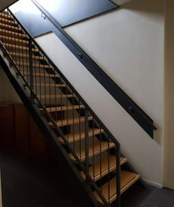 After taking the elevator to the third floor, you will have to walk down an outside corridor and then after getting inside again you have to take the stairs to get to our apartment at the top floor!