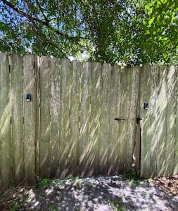 The path from the driveway leads you around the left side of the house to the gate, which I've installed solar lights on to help you find the latch.