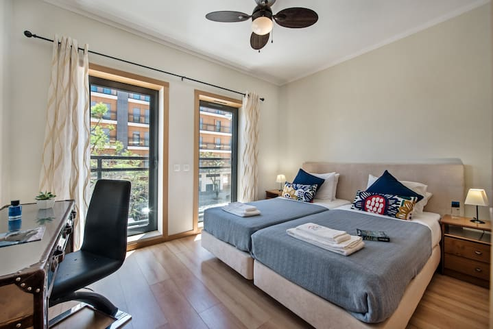 Smart and stylish twin beds with air con and shutters