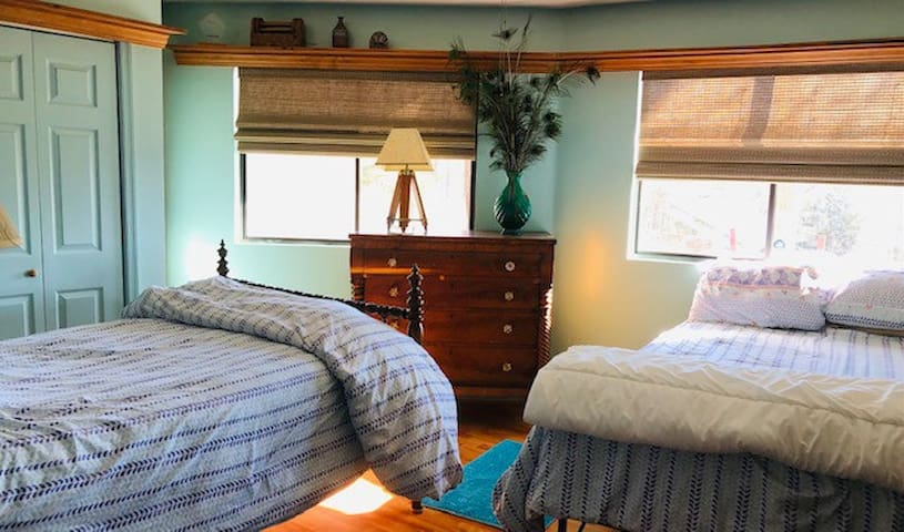 Second bedroom with queen and double beds.
