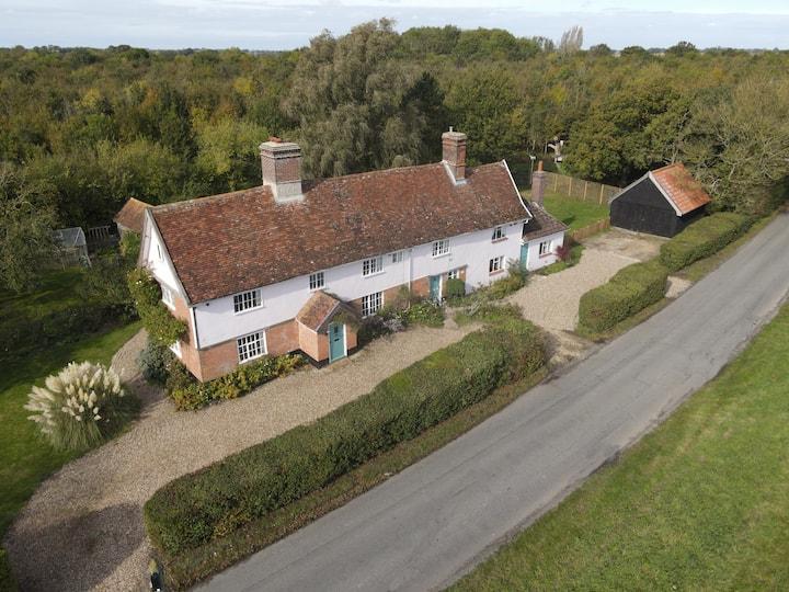Characterful half-timbered Tudor farm house (half)