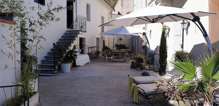 charming guesthouse and its paved courtyard