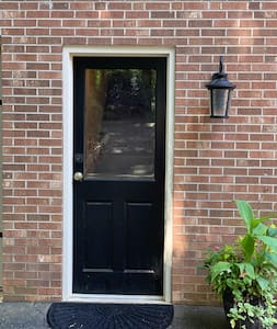 Light at the front door turns on automatically at dusk and stays on until it is light outside again.
