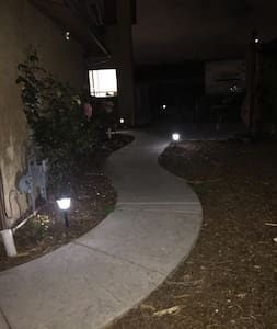 Well lit walkway to the house w good ambiance. (Looks better and brighter than the photo)