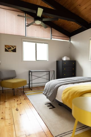 Yellow bedroom: You can see the desk here. It can be easily moved to any room.