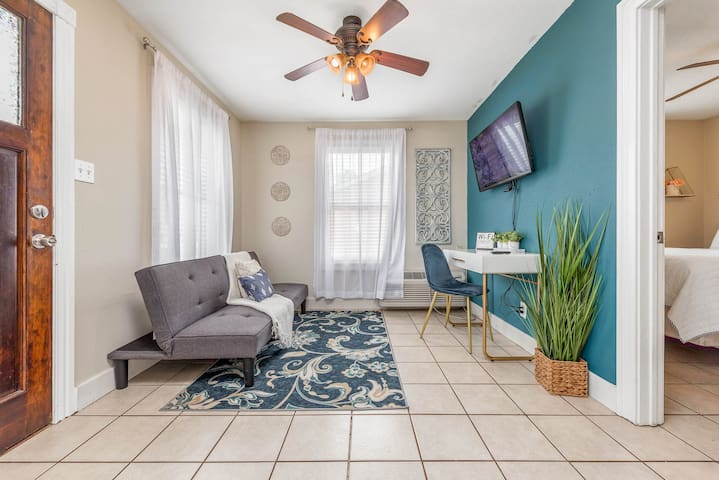 enjoy our cozy living room with a futon that folds out into a full size bed, and a tv with Roku so you can catchup on all your favorite shows.