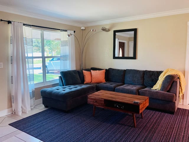 bright and airy living room with cable TV