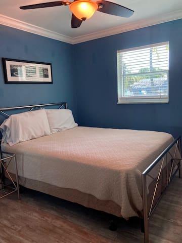 guest bedroom 1 with queen bed