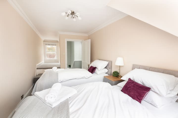 Bedroom 4:  The Pink Room: Pocket sprung super comfy beds dressed in Egyptian Cotton Linen.  Sleeps up to 3 guests.  Beds can be set as twins or super king-sized