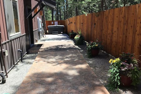 Flat side walk past hot tub to private entry door