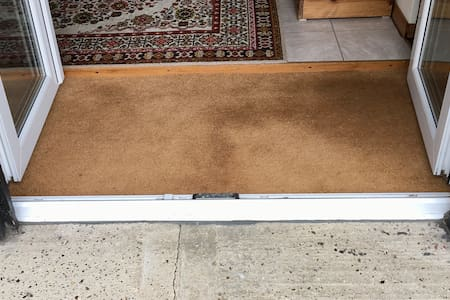 There is a slight lip over the patio doors onto the door mat and another slight lip up to the flooring