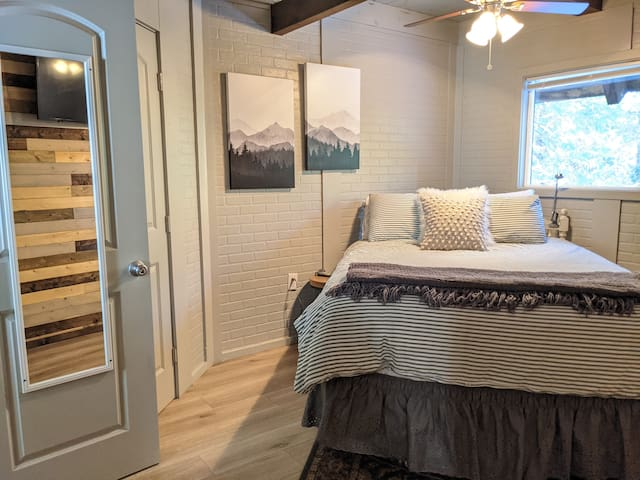 The only bedroom on the ground floor has entrance to the first floor bathroom. There is a dresser and smart tv for guest use.