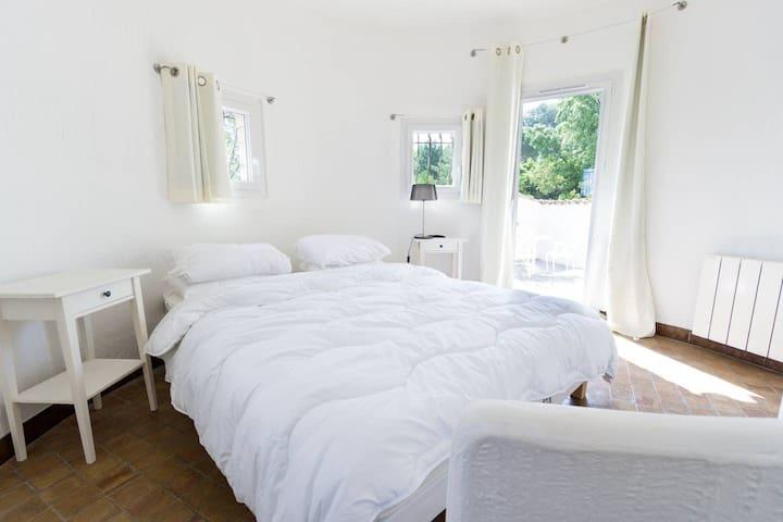 bedroom first floor (tower room) with queen bed