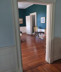 Entrance from the living room to the parlor and into the foyer.  All doorways are wide.