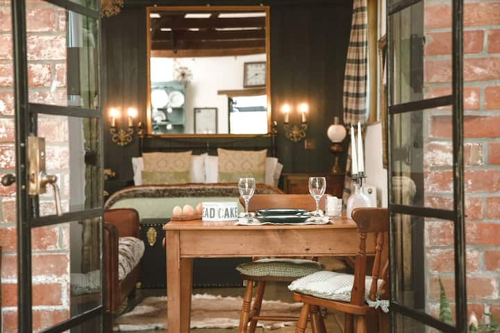 The Sty | Rustic luxury cottage, studio with fire.