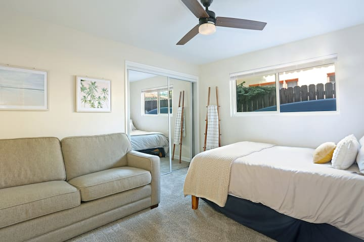 """Our third bedroom has a queen bed and a very comfortable memory foam sofabed.  The plush carpet in here also makes this room very comfortable for kids to play.  Equipped with 55"""" TV and a PlayStation."""