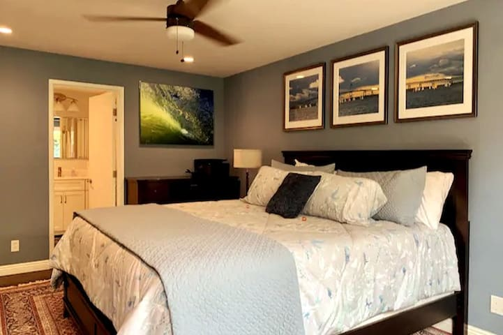 """The Master Bed Room has a California King bed with plenty of storage for your clothes and personal items.  It also has black-out curtains so you can sleep in if you choose.  The bedroom also has a 50"""" TV if you prefer to binge-watch Netflix in bed :)"""