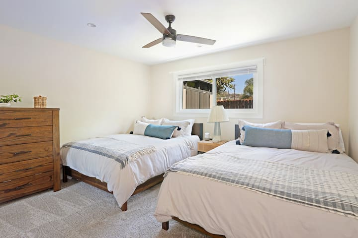 The second bedroom has two queen beds with new premium mattresses.  This room also has a TV for late night netflix binges.