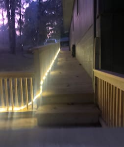 The ramp to the private entrance is well lit at night.