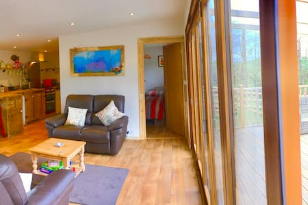 Bifold doors makes for easy access to the Lodge.