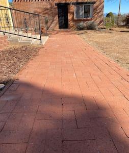 Flat brick walkway with minor bumps