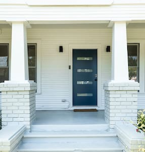 The front porch is lit by two outdoor lights as you make your way to the front door.