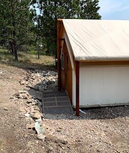 Ramp to back door. Please note it is a gravel walkway to metal ramp.