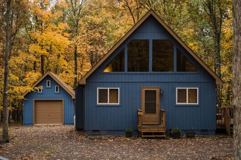 Modern a-frame cabin with lake access