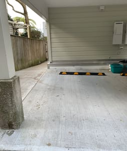 Carport parking for air bnb guests next to wide path to front door